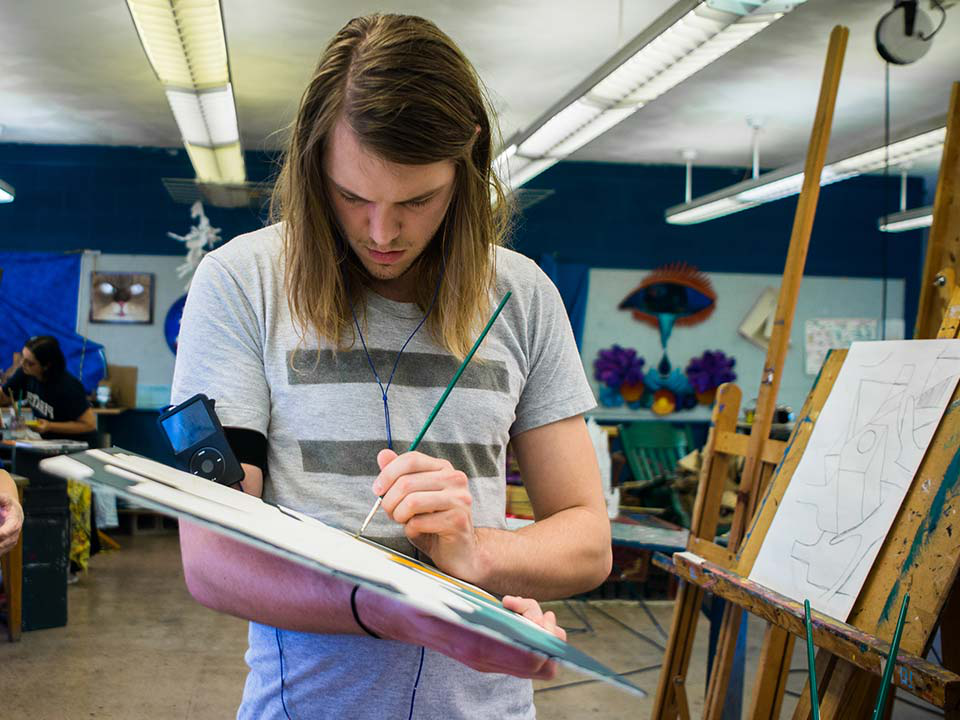 student painting in studio