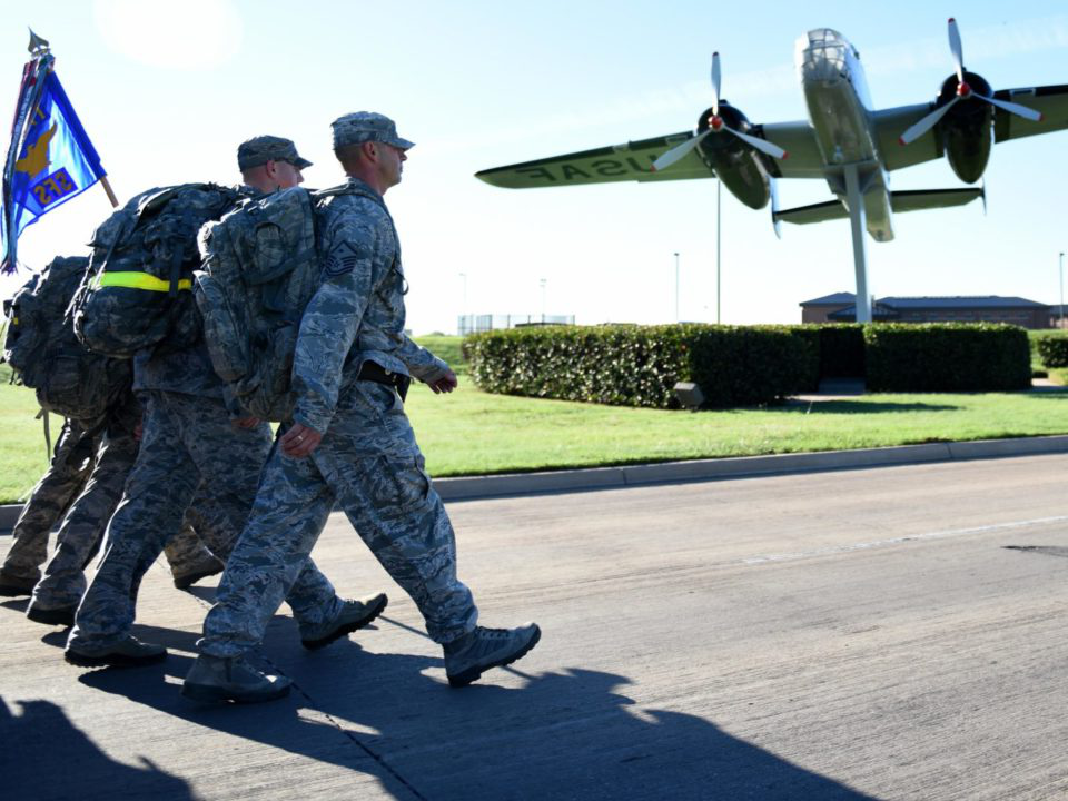 military members walking towards plane
